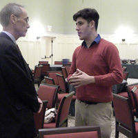 Panelist and judge Sam Novey conversing with Charles Center Director Joel Schwartz/Jane M. Kim
