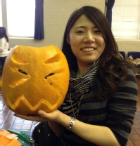 Chelsea Liu '13 at the International Students, Scholars, and Programs pumpkin carving event.