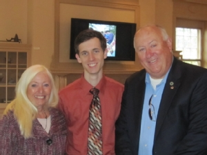 David Newbrander '13 with Jeanne and Don Weaver.