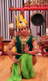 A guest performer from the Indonesian embassy accompanying the W&M Gamelan Ensemble.
