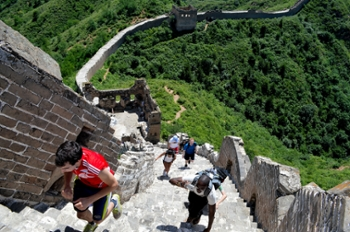 W&M students climb steps at the Great Wall of China in Beijing.  Photo by David So.