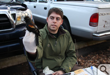 Andy McGann holds a redwing blackbird, a cousin of the target rusty blackbird.