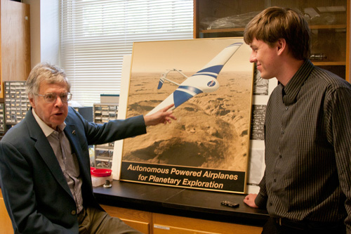 Research Professor Joel Levine  discusses the ARES Mars mission with W&M geology major Andrew Follett '13