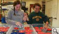 Shelby Ziegler '13 (left) and Selma Abdel-Raheem '15 work on breeding sea urchins