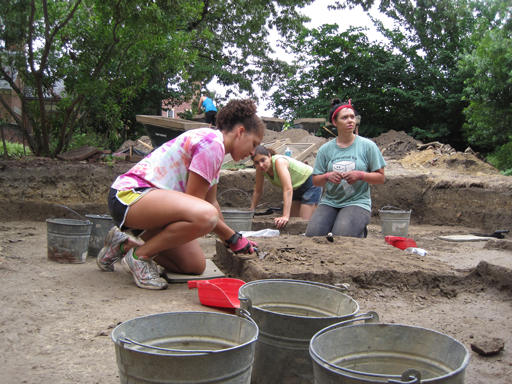 Using trowels, field school participants (from left) Celine Alasomuka '14, Teaching Assistant Rebecca Schumann M.A. '13 and Julia Gibson '13