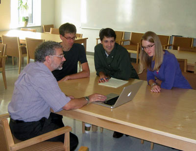 Data review  Some of the William & Mary collaborators review the QWeak experiment. From left, David Armstrong, Wouter Deconinck, Joshua Magee and Valerie Gray.