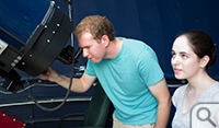 Jacob Gunnarson and Alexandra Cramer using the Meade telescope