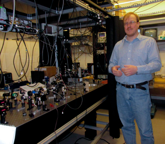 Eugeniy E. Mikhailov, assistant professor of physics at William & Mary, explains to the media his lab's role in quantum noise suppression to increase the sensitivity of the LIGO apparatus.