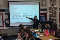 widget-spring-2017-volunteer-teacher-yanmin-liu-leads-students-at-matthew-whaley-elementary-school-in-an-exercise-to-introduce-themselves-in-chinese..jpg