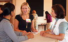 three women talking at event